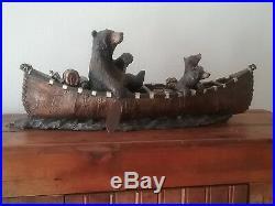 Bear sculpture Canoe trip. Big sky carvery J. Fleming. 6 in. X 24in. Nice