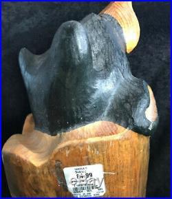 Big Sky Carvers Bearfoot Bear in A Log