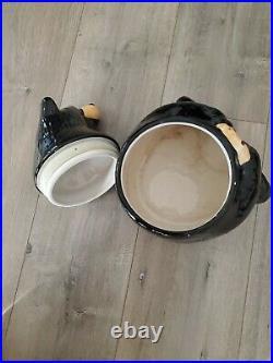 Big Sky Carvers presents. BearFoots Black Bear holding Choc. Chip Cookie Jar